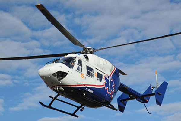 White and blue helicopter in flight