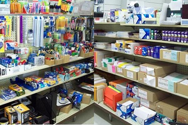 Office supplies stored on shelves at KelPrint