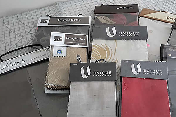 Samples of draperies in red, gray and brown tones