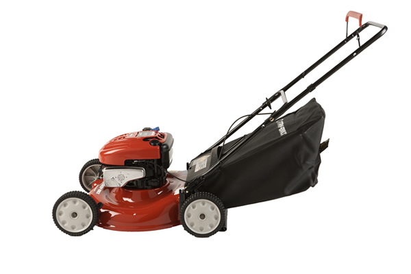 red gas lawnmower with a black bag attached for grass clippings