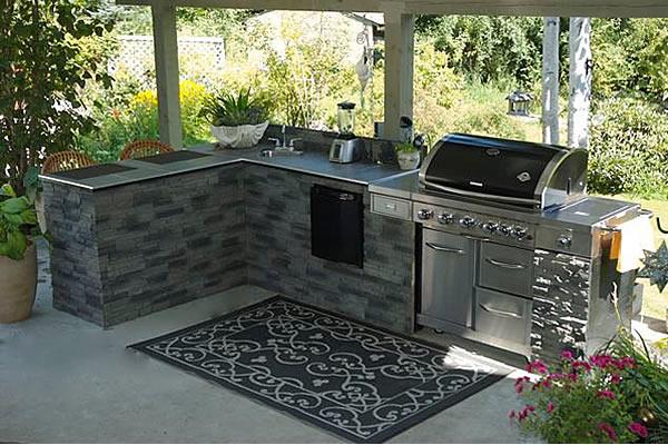 stainless steel barbecue set up with an outdoor kitchenette