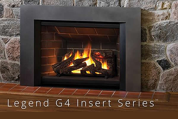 Legend G four insert fireplace in a living room with rock work displayed for accent