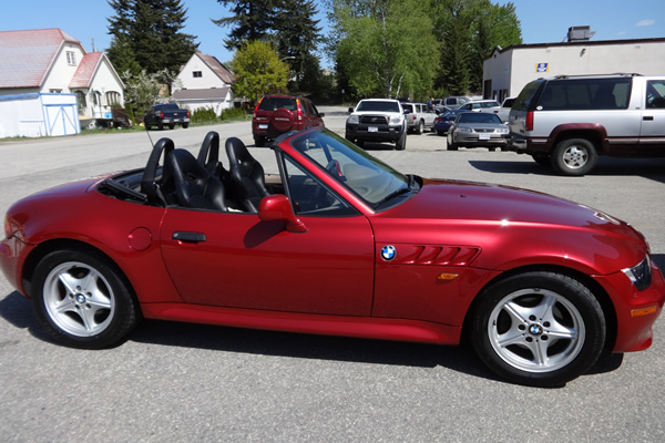 red sports car with its top down