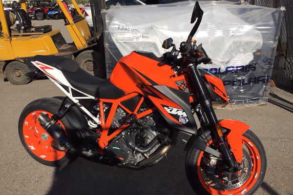 orange and black motorcycle with protective metal coating