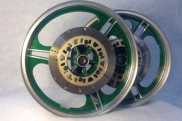 powder coated wheel rims in green and silver with brass on the center