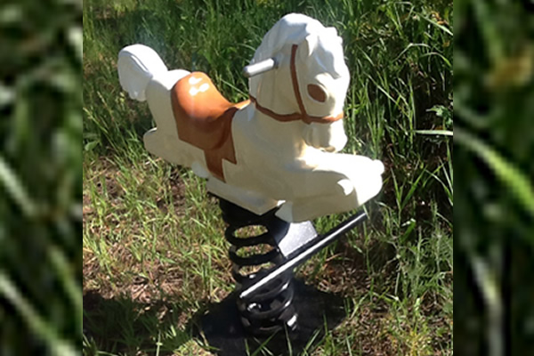 a metal horse with white and brown protective coating for a child to sit on and ride