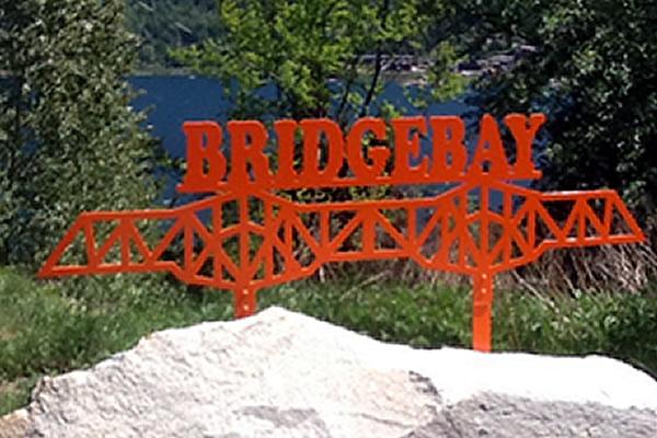 red powder coating on a metal sign that reads bridgebay