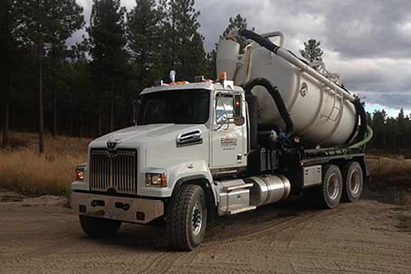 white semi with a white tank holding sewage and waste
