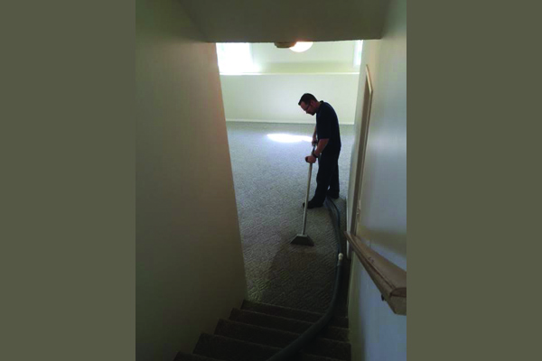 a man professionally cleaning a carpet