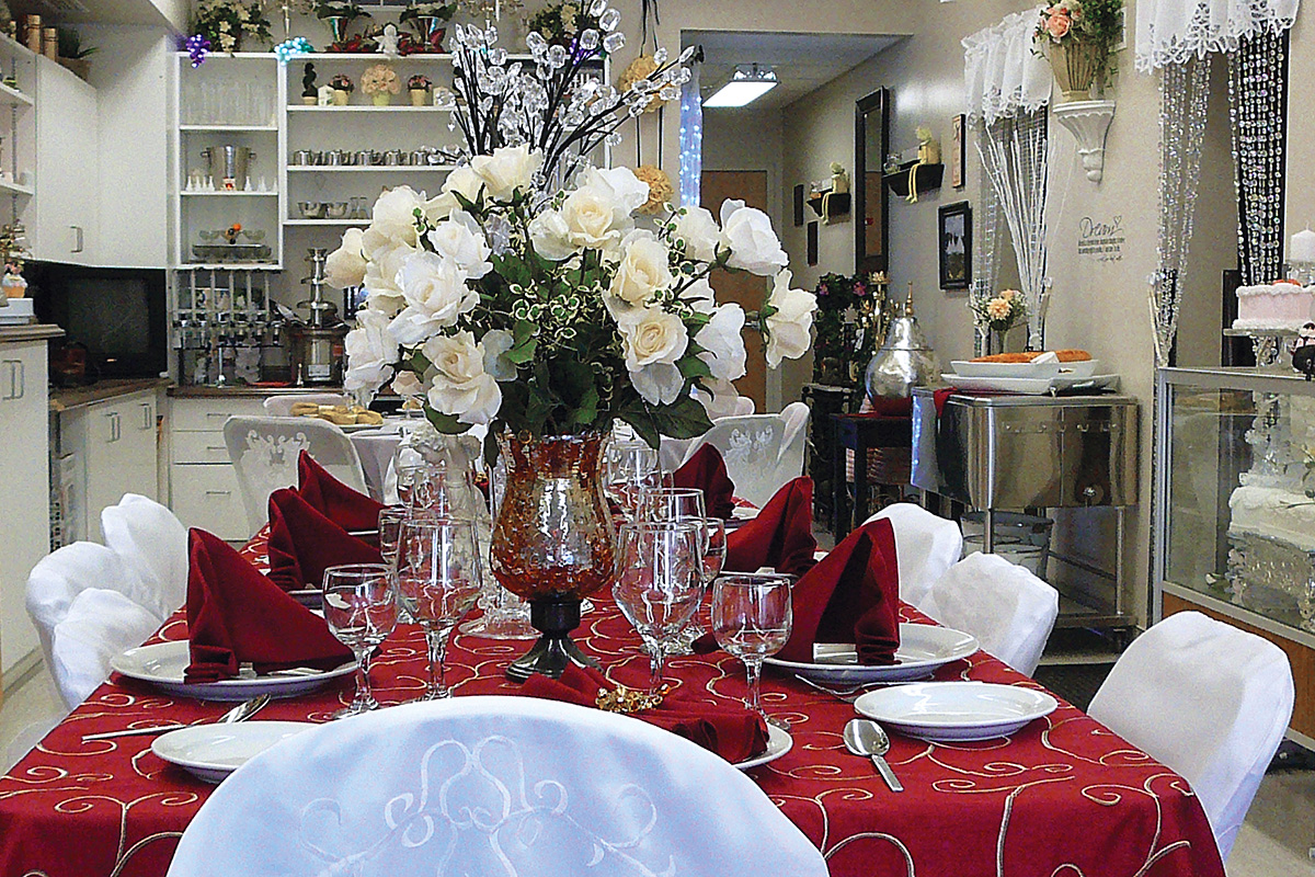 Wedding and party supplies including table and chairs, flowers, cutlery and glasses