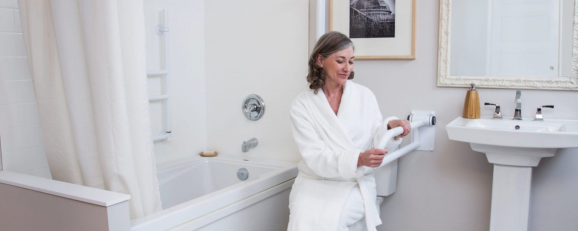 Elderly woman using bathroom safety products