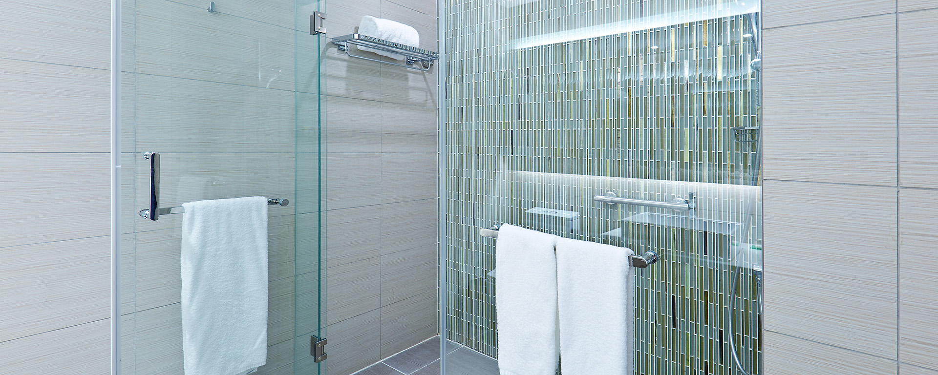 Tile in a shower enclosed with tempered glass