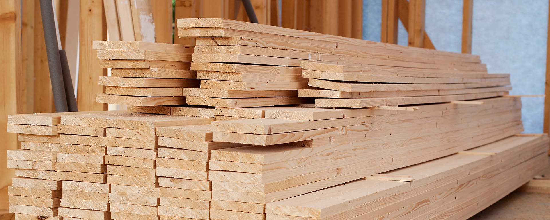Pile of lumber at a construction site.